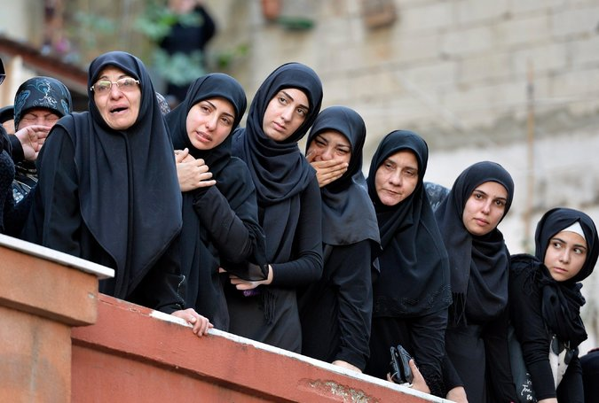 The relatives of one of the victims of the twin suicide attacks in Beirut mourned during a funeral procession in the city's Burj al-Barajneh neighborhood. Credit Wael Hamzeh/European Pressphoto Agency